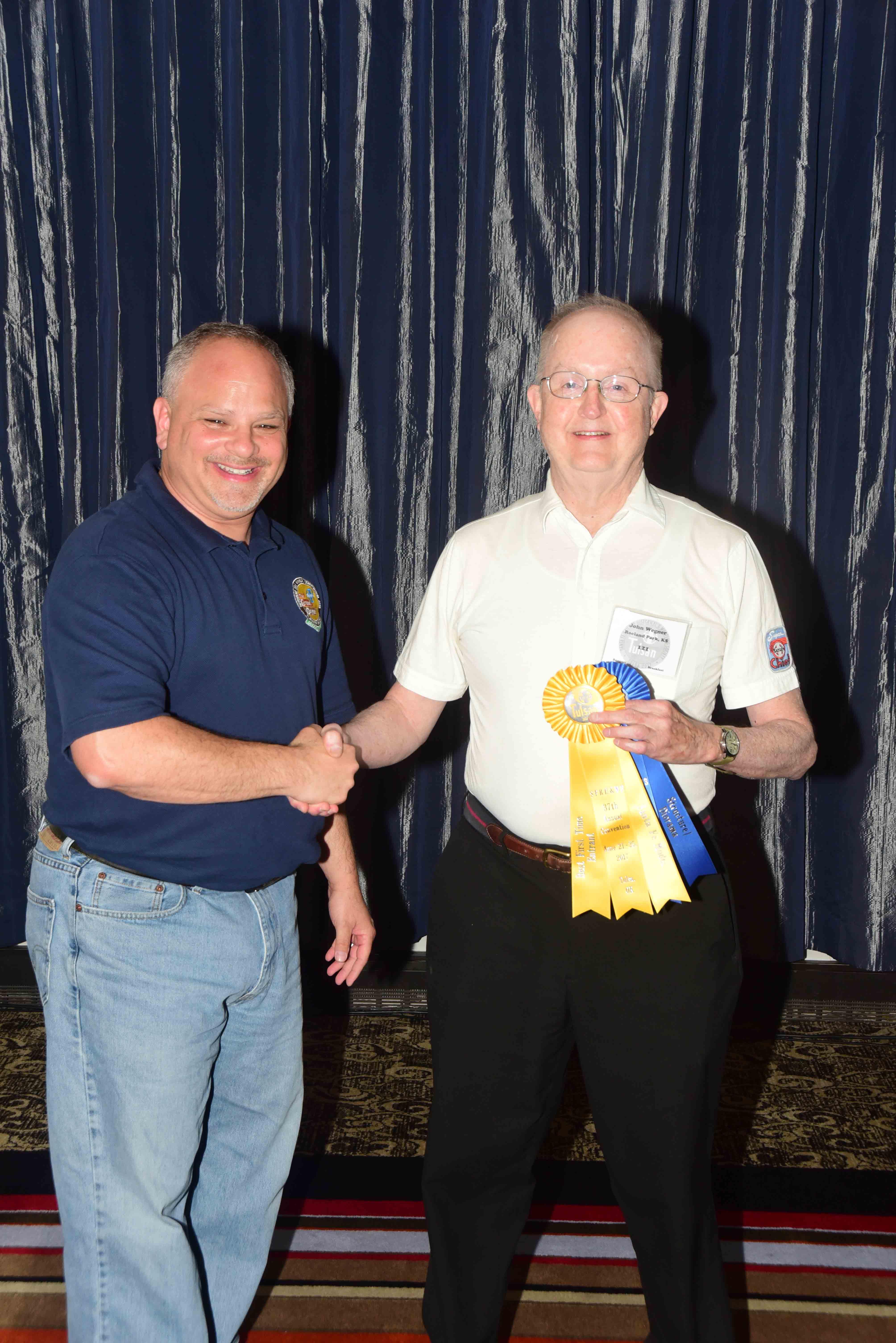 John Hotvet accepting Best First Time Entry ribbon