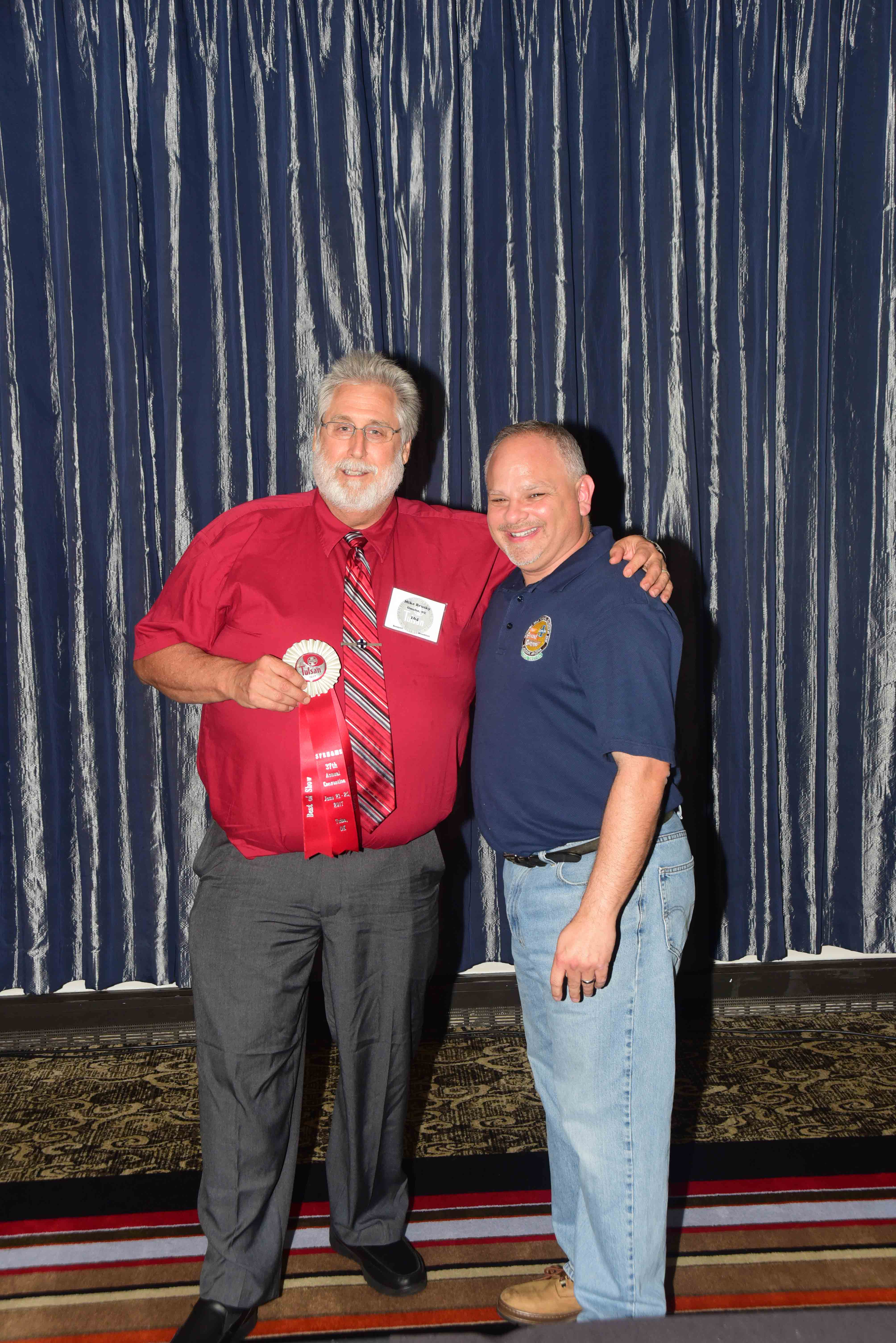 Mike Brusky receiving Best of Show ribbon
